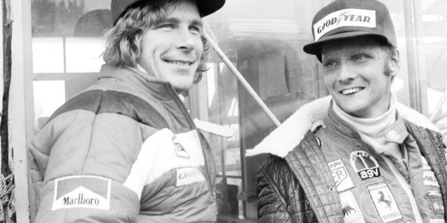 FILE - In this Oct. 24, 1976, file photo, Austrian auto racer Niki Lauda, right, defending champion in world driving, and James Hunt, of Britain, look at the rain before the start of the Japan Grand Prix Formula One auto race at Fuji International Speedway, Gotemba, Japan.