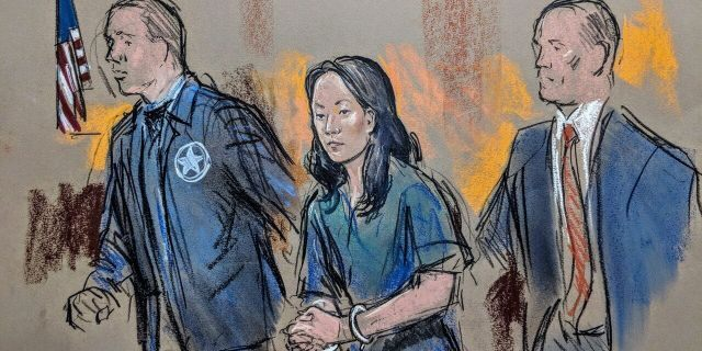 Yujing Zhang being led into federal court in West Palm Beach, Fla., in April.