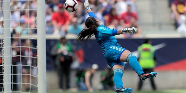 Mexico goalkeeper Cecilia Santiago diving at a shot by U.S. forward Megan Rapinoe. The shot went wide of the goal. (AP Photo/Julio Cortez)