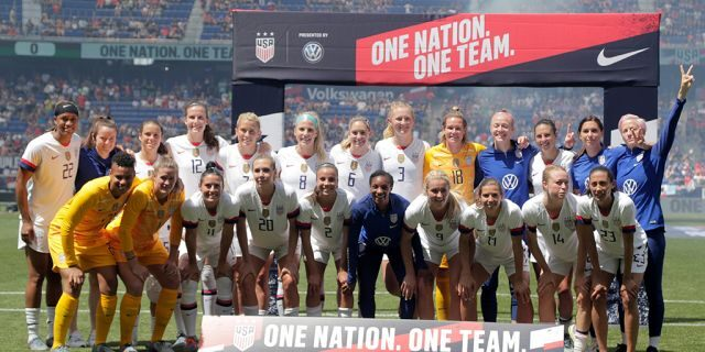Members of the United States women's national team gathering for fans during the send-off ceremony after the match. (AP Photo/Julio Cortez)