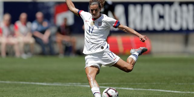 Tobin Heath shooting a scoring shot against Mexico during the first half of the match. (AP Photo/Julio Cortez)