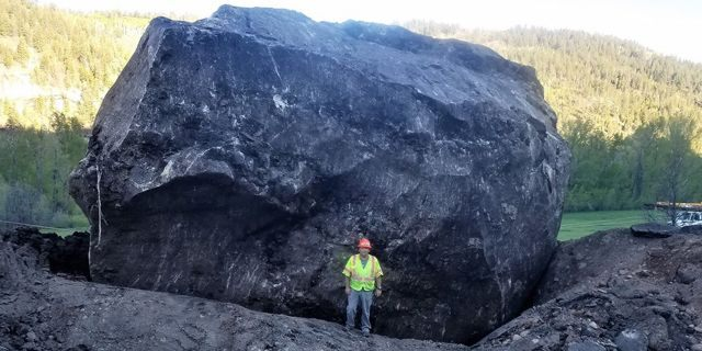 """A """"significant"""" rock fall left a pair of massive boulders along Colorado Highway 145 about 12 miles north of Dolores on Friday afternoon, according to officials."""