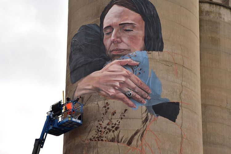Artist defends controversial mural of New Zealand prime minister embracing Muslim woman