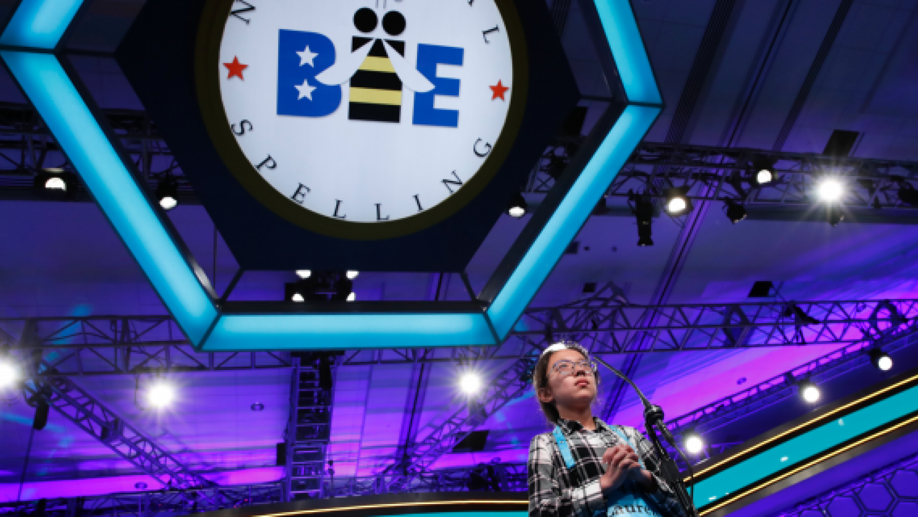 FILE - In this May 31, 2018 file photo, Lauren Guo, 12, from Arvada, Colo., competes in the Scripps National Spelling Bee in Oxon Hill, Md.  An unremarkable sound can be the toughest thing for spellers to master at the Scripps National Spelling Bee. It
