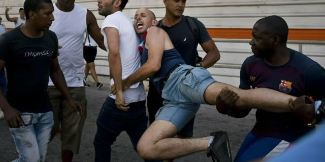 Cuban police detain a gay rights activist taking part in an unauthorized march in Havana, Cuba, Saturday, May 11, 2019. The march was organized largely using Cuba