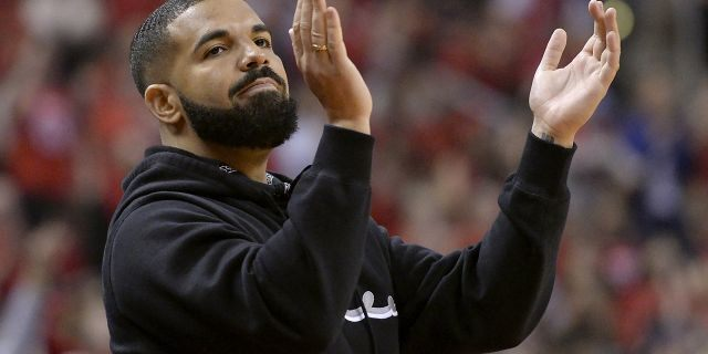 Drake cheers from courtside during the first half of Game 6 of the NBA basketball playoffs Eastern Conference finals between the Toronto Raptors and the Milwaukee Bucks on Saturday, May 25, 2019, in Toronto. (Associated Press)