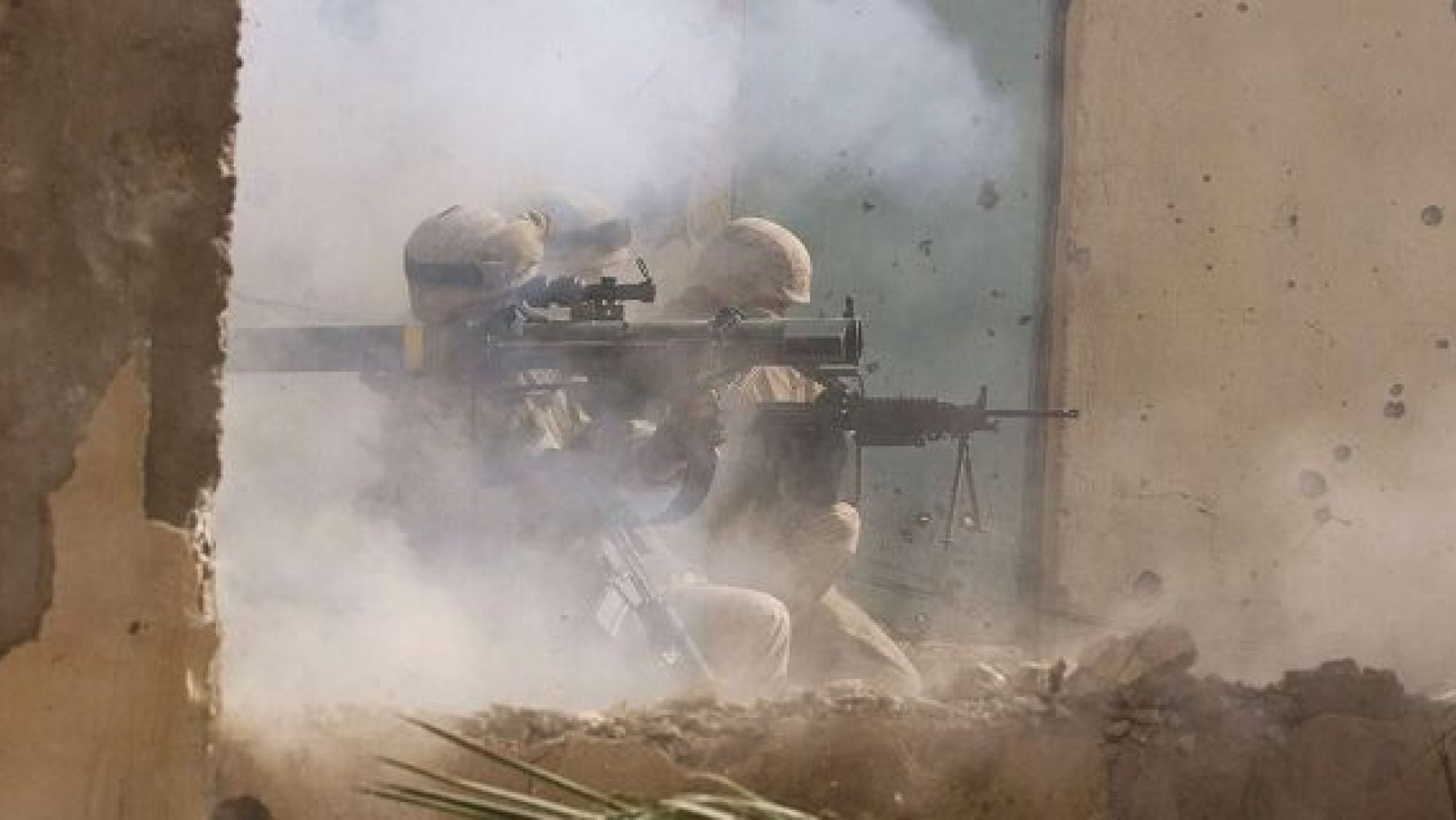 FILE -- NOVEMBER 23, 2004: U.S. Marines of the Light Armored Reconnaissance (LAR) company of 1st Battalion 3rd Marines, fire a rocket to clear houses at the site where four insurgents staged a bloody counter-attack, killing one American and wounding many others in Fallujah, Iraq. (Photo by Scott Peterson/Getty Images)