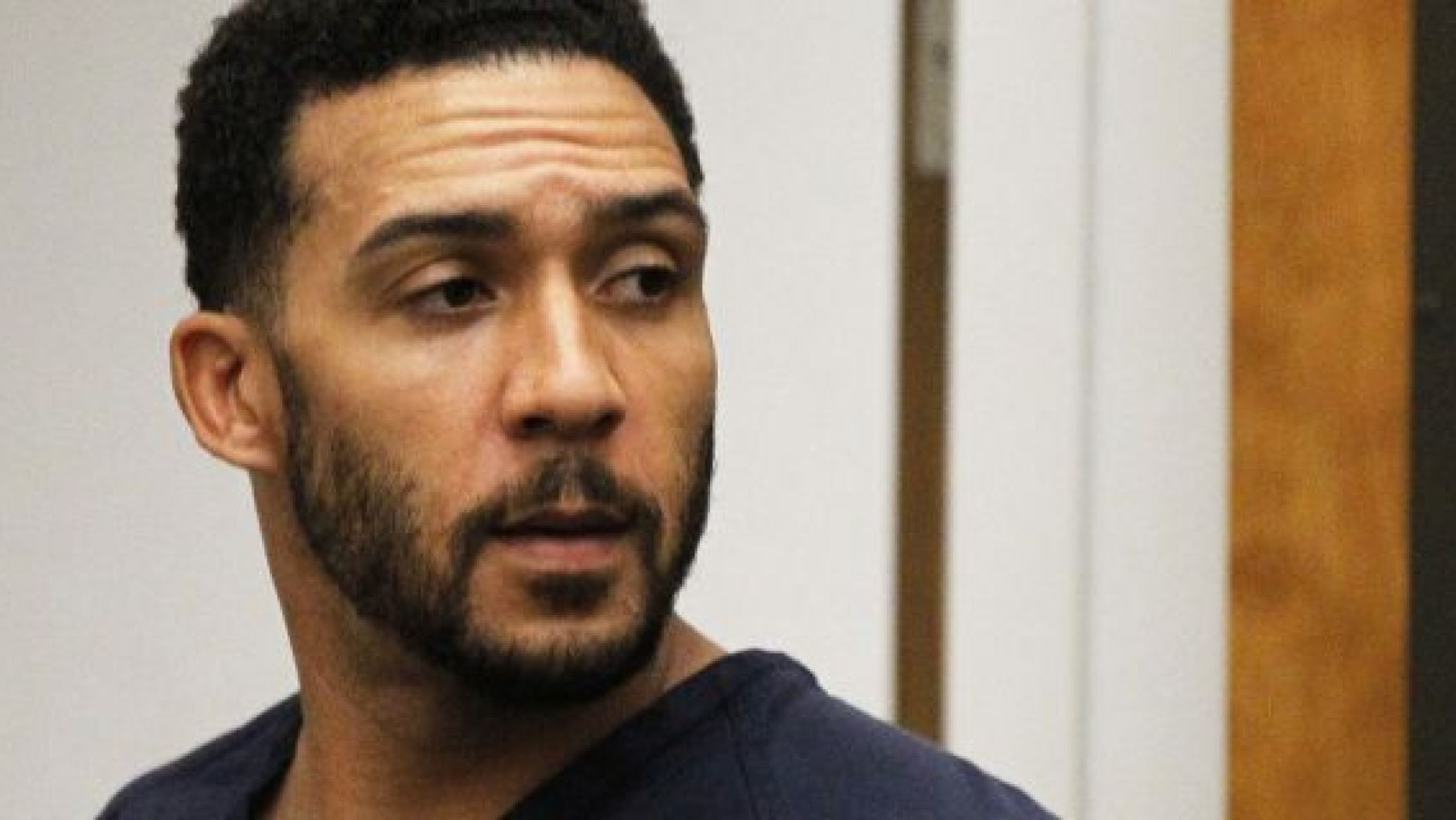FILE - Former NFL football player Kellen Winslow Jr., center, leaves his arraignment in Vista, Calif. AP/Pool
