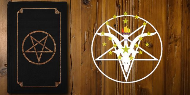 Close-up on a black book with a gilded Reverse Pentagram on a brown board.