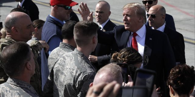 President Donald Trump greets troops after landing at Joint Base Elmendorf-Richardson for a refueling stop en route to Japan Friday, May 24, 2019, in Anchorage. (Associated Press)