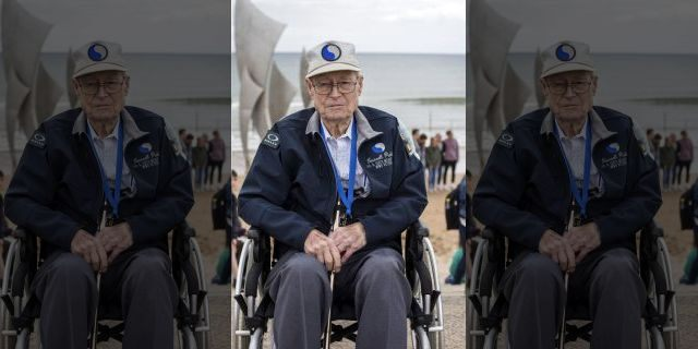 United States World War II veteran Russell Pickett, from Tennessee, poses at Omaha Beach in Saint-Laurent-sur-Mer, Normandy, France, Monday, June 3, 2019.