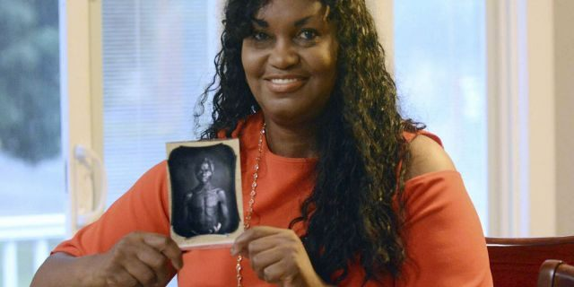 Tamara Lanier holds an 1850 photograph of Renty, a South Carolina slave who Lanier claims is her great-great-great grandfather.