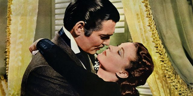 """Rhett Butler (Clark Gable) embraces Scarlett O'Hara (Vivien Leigh) in a famous scene from the 1939 epic film """"Gone with the Wind."""""""