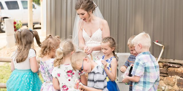 Eight of Geary's former students surprised their teacher on her big day with hugs, cheers and a lemonade-and-cookie reception.
