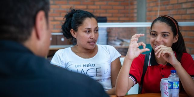 Jheyde Yepez, 13, speaks to World Vision U.S. President Edgar Sandoval Sr. about her experience fleeing Venezuela and settling in Colombia. Jheyde used to beg on the streets, now thanks to World Vision she is able to attend school and is hoping to start her own business in English translation.