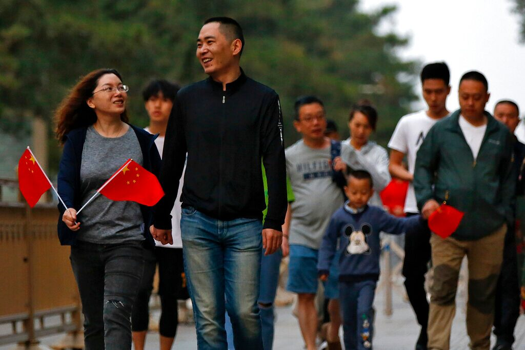 China issues citizens US travel alert, warns of harassment