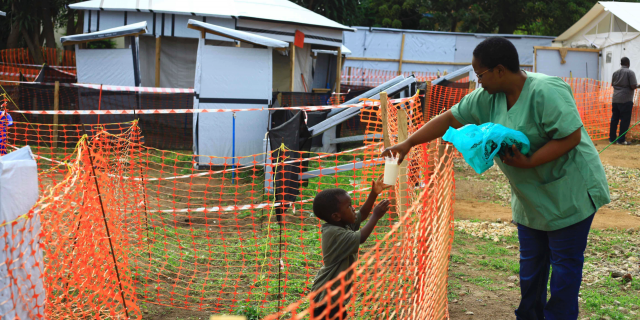 In this Sunday, Sept. 9, 2018 file photo, a health worker feeds a boy suspected of having the Ebola virus at an Ebola treatment center in Beni, Eastern Congo.