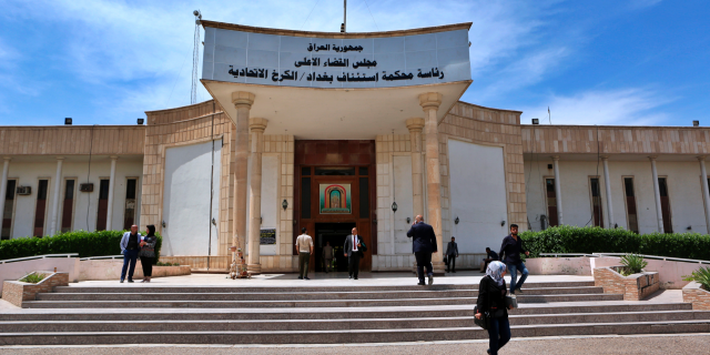 In this Sunday, May 5, 2019 file photo, people walk outside Iraqi Criminal Court in Baghdad's Karkh district, Iraq.