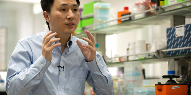 In this Oct. 10, 2018 photo, He Jiankui speaks during an interview at a laboratory in Shenzhen in southern China