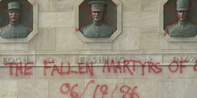 """Vandals spray-painted """"Glory to the fallen martyrs,"""" on the World War I Memorial"""