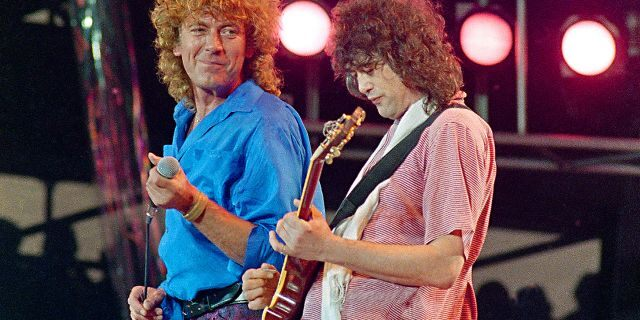 In this July 13, 1985 file photo, Led Zeppelin bandmates, singer Robert Plant, left, and guitarist Jimmy Page, reunite to perform for the Live Aid famine relief concert at JFK Stadium in Philadelphia.