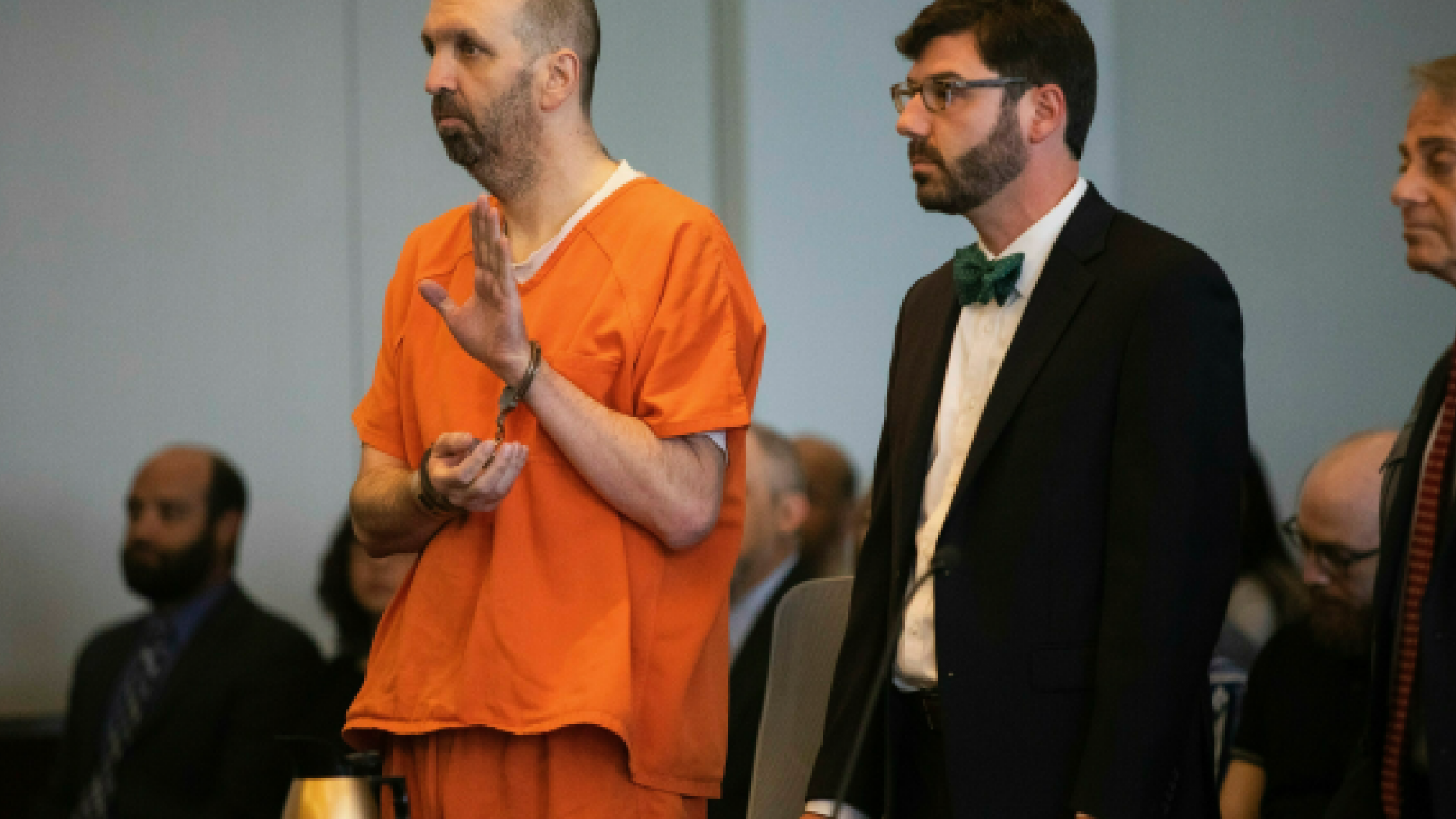 Craig Hicks pleads guilty to first-degree murder in the 2015 murders of three young Muslims at a Chapel Hill apartment Wednesday, June 12, 2019 at the Durham County Courthouse. Hicks will serve a life sentence in prison without the possibility of parole for killing his neighbors at the Finley Forest Condominiums: Deah Barakat, 23, his wife Yusor Abu-Salha, 21, and her sister Razan Abu-Salha, 19.  (Travis Long/The News & Observer via AP)