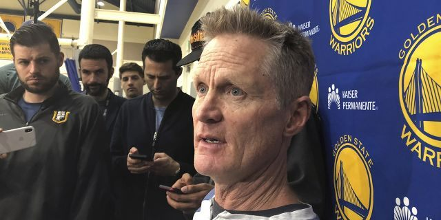 Golden State Warriors coach Steve Kerr talks with reporters at the NBA basketball team