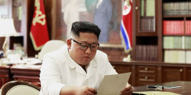 In this undated photo provided on Sunday, June 23, 2019, by the North Korean government, North Korean leader Kim Jong Un reads a letter from U.S. President Donald Trump. (Korean Central News Agency/Korea News Service via AP)