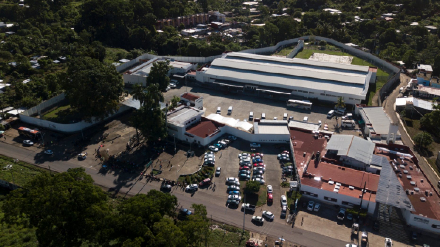 This June 1, 2019 photo, shows the Siglo XXI migrant detention center in Tapachula, Chiapas state, Mexico. As of late April there were more than 2,000 migrants in Siglo XXI, according to the commission, over double its 960 capacity. (AP Photo/Pedro Giron)