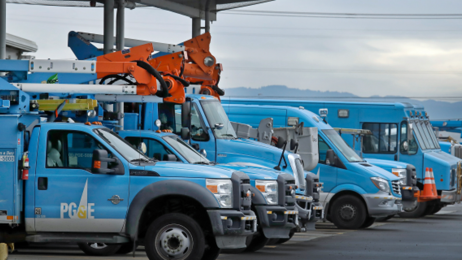 FILE - In this Jan. 14, 2019, file photo, Pacific Gas & Electric vehicles are parked at the PG&E Oakland Service Center in Oakland, Calif. The year