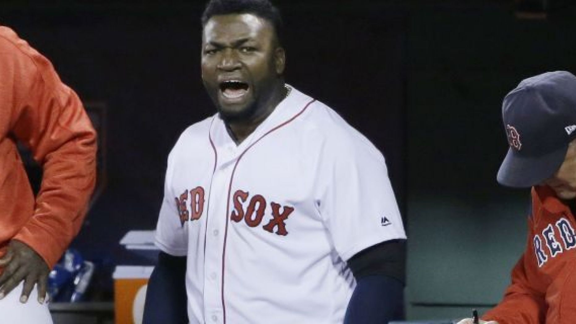 FILE - In this Oct. 10, 2016, file photo, Boston Red Sox designated hitter David Ortiz encourages the crowd from the dugout during the eighth inning in Game 3 of baseball