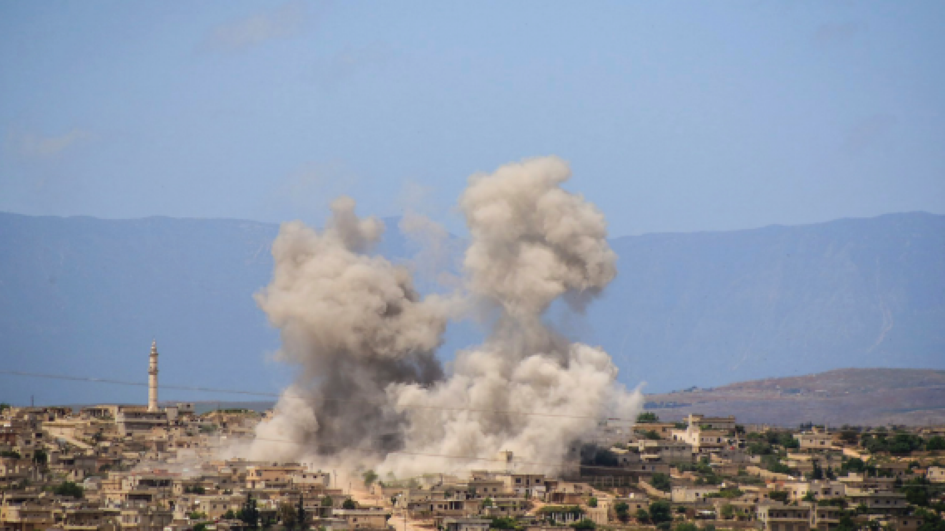 FILE - In this May 3, 2019 file photo, provided by the Syrian Civil Defense White Helmets, which has been authenticated based on its contents and other AP reporting, shows smoke rising after Syrian government and Russian airstrikes that hit the town of al-Habeet, southern Idlib, Syria. In their latest assault on the last rebel-stronghold of Idlib, the Syrian government and its Russian backer have resorted to familiar tactics to break the will of people and pressure civilians to flee: Target residential areas, bomb hospitals and markets, destroy civilian infrastructure. It is a well-established pattern that worked for President Bashar Assad