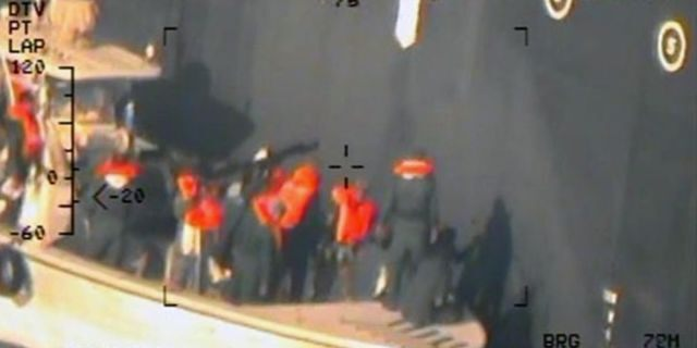Members of the Islamic Revolutionary Guard Corps (IRGC) Navy remove an unexploded mine from the hull of the M/T Kokuka Courageous in the Gulf of Oman last week