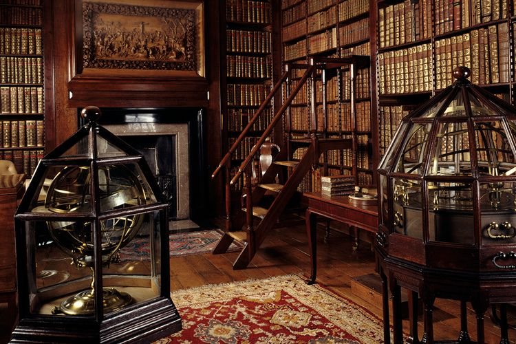 What was the real purpose of the English country house library?