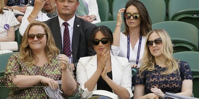 Meghan, Duchess of Sussex, center, applauds from her seat on Court Number One during day four of the Wimbledon Tennis Championships. (AP Photo/Tim Ireland)