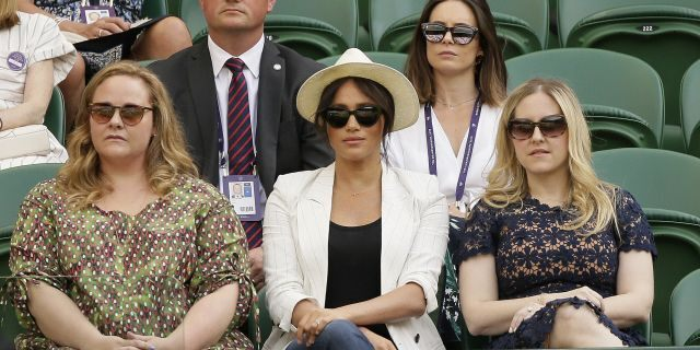 The Duchess of Sussex watches Serena Williams play Kaja Juvan in a singles match during day four of the Wimbledon Tennis Championships. (AP Photo/Tim Ireland)