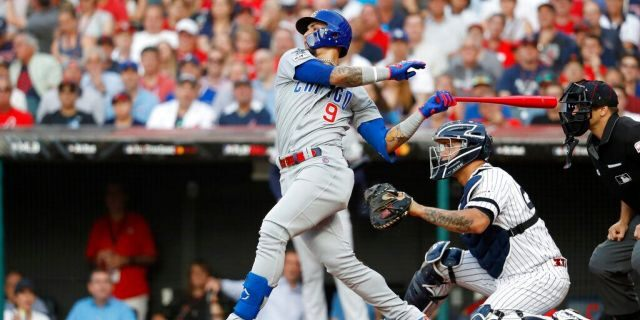 National League Javier Baez, of the Chicago Cubs, swings during the first inning of the MLB baseball All-Star Game against the American League.