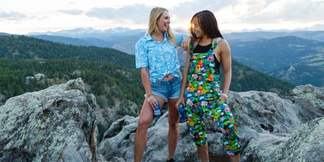 """The official line offers swimwear, robes, Hawaiians and """"pajameralls"""" – overalls made with sweatpant fabric – with the popular lager's brand printed on them."""