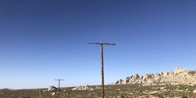 A search helicopter hovers overhead in the Mojave Desert near Needles, Calif., Saturday, July 13, 2019. Authorities in California say they are searching for a bikini-clad Arizona woman who went missing while hiking in the Mojave Desert. (AP Photo/Dario Lopez-Mills)
