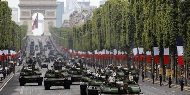 Tanks rolling on the Champs-Elysees avenue during the Bastille Day parade in Paris, France, Sunday, July 14, 2019.