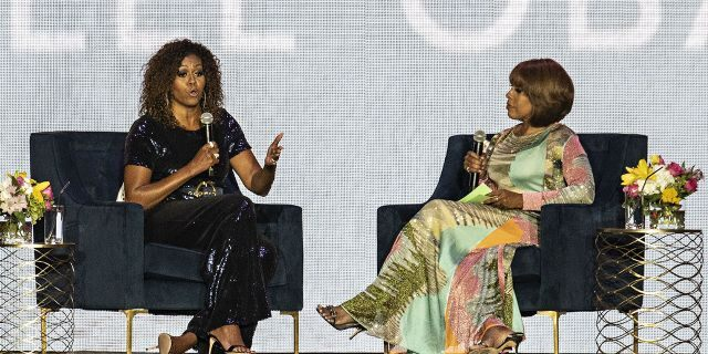 Michelle Obama speaks to Gayle King during the 2019 Essence Festival at the Mercedes-Benz Superdome, Saturday, July 6, 2019, in New Orleans. (Photo by Amy Harris/Invision/AP)