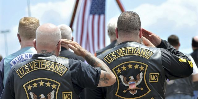 Members of the U.S. Veterans Motorcycle Club salute the flag during the playing of the National Anthem. (Mark Stockwell/The Sun Chronicle via AP)