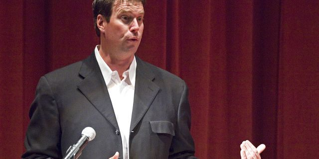 Ryan Leaf has been hired by ESPN to be a college football analyst, another step in the remarkable comeback of the former Washington State star who has battled drug addiction and served time in prison. (Dean Hare/The Moscow-Pullman Daily News via AP, File)