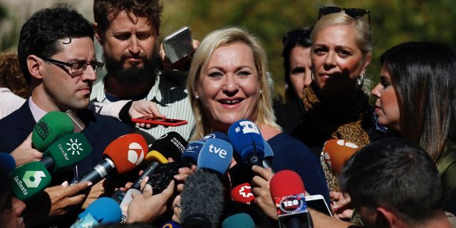 Ines Madrigal speaks to journalists outside a court in Madrid, Spain. A woman who became a crusader for babies abducted during Spain