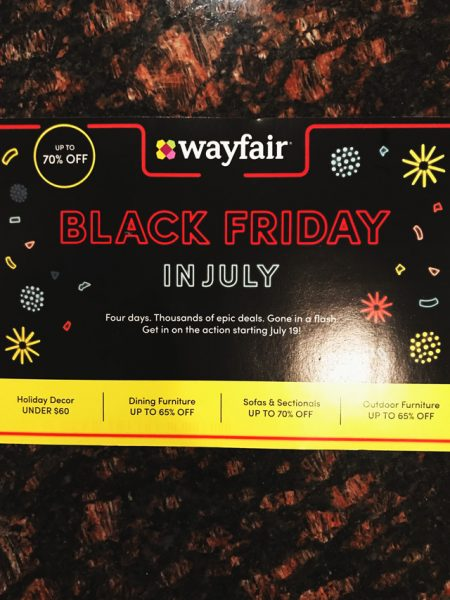 wayfair black friday in july sale banner migrant camp scandal