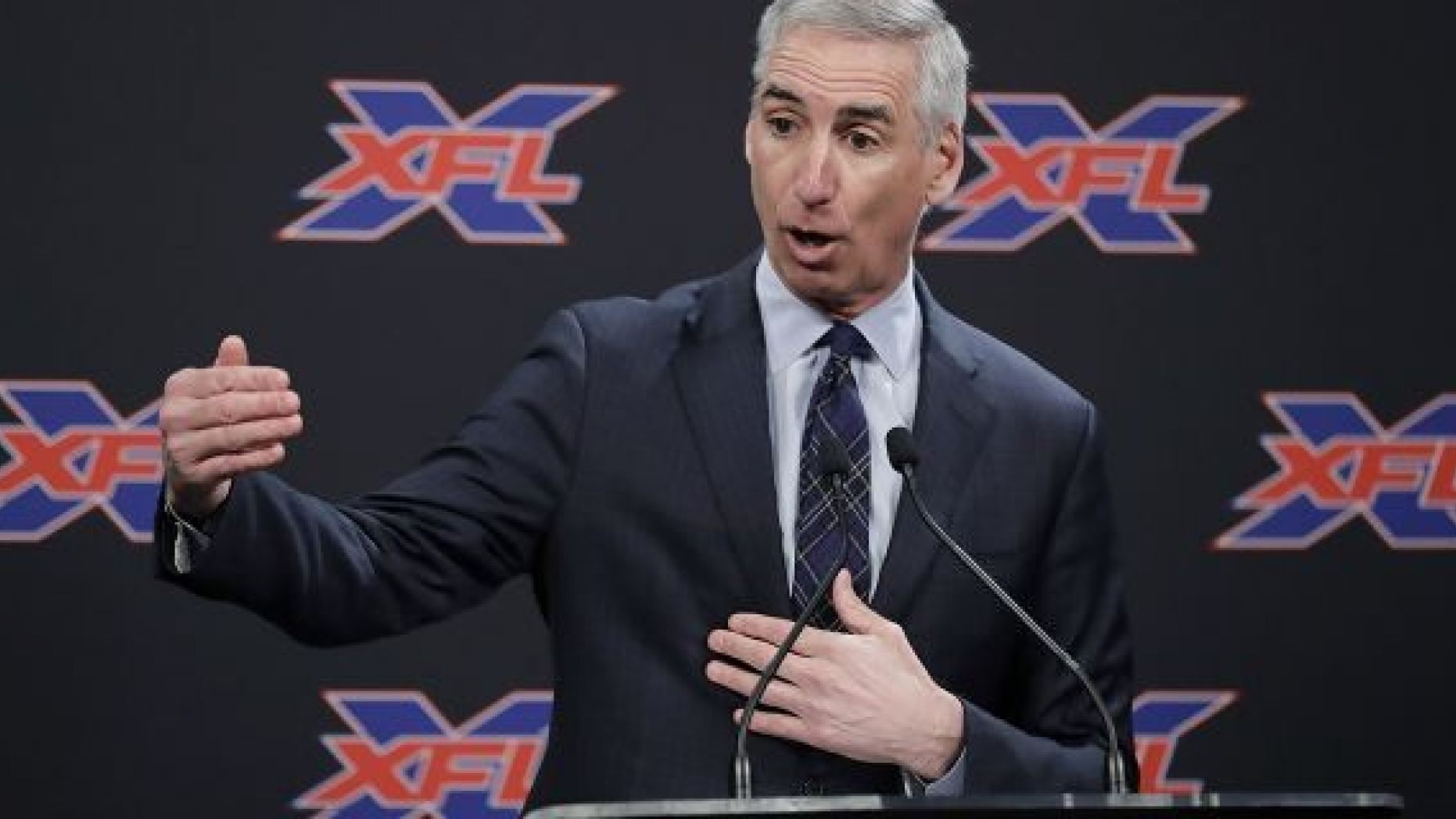 FILE - In this Feb. 25, 2019, file photo, XFL Football Commissioner Oliver Luck talks to reporters before introducing former NFL football quarterback Jim Zorn as the head coach for Seattle