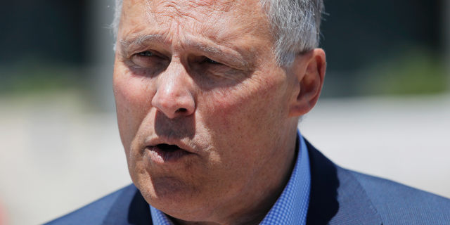 Democratic Presidential candidate Washington Gov. Jay Inslee participates in a climate change rally Friday, May 24, 2019, in Las Vegas. (AP Photo/John Locher)