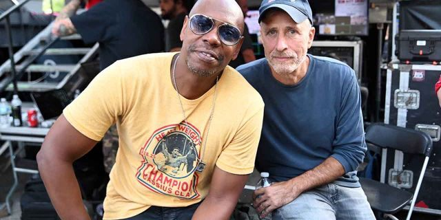 Dave Chappelle and Jon Stewart pose backstage during Dave Chappelle's Block Party on Aug. 25, 2019 in Dayton, Ohio.