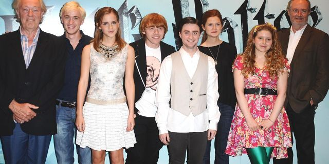 """From left: Michael Gambon, Tom Felton, Emma Watson, Rupert Grint, Daniel Radcliffe, Bonnie Wright, Jessie Cave and Jim Broadbent are seen at a photocall to launch the new film, """"Harry Potter and the Half-Blood Prince,"""" in London (Photo by Ian West/PA Images/PA Images via Getty Images)"""