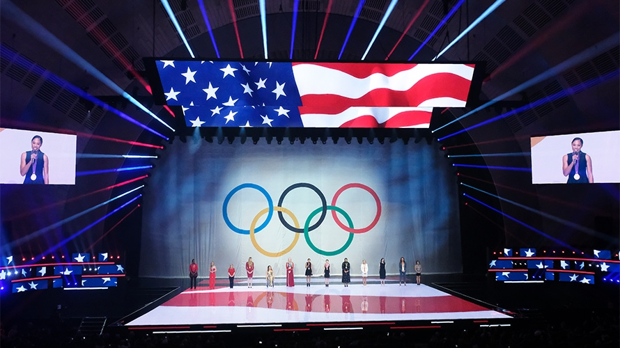 nbcuniversal upfront event at radio city music hall showing a stage with olympic rings and the american flag